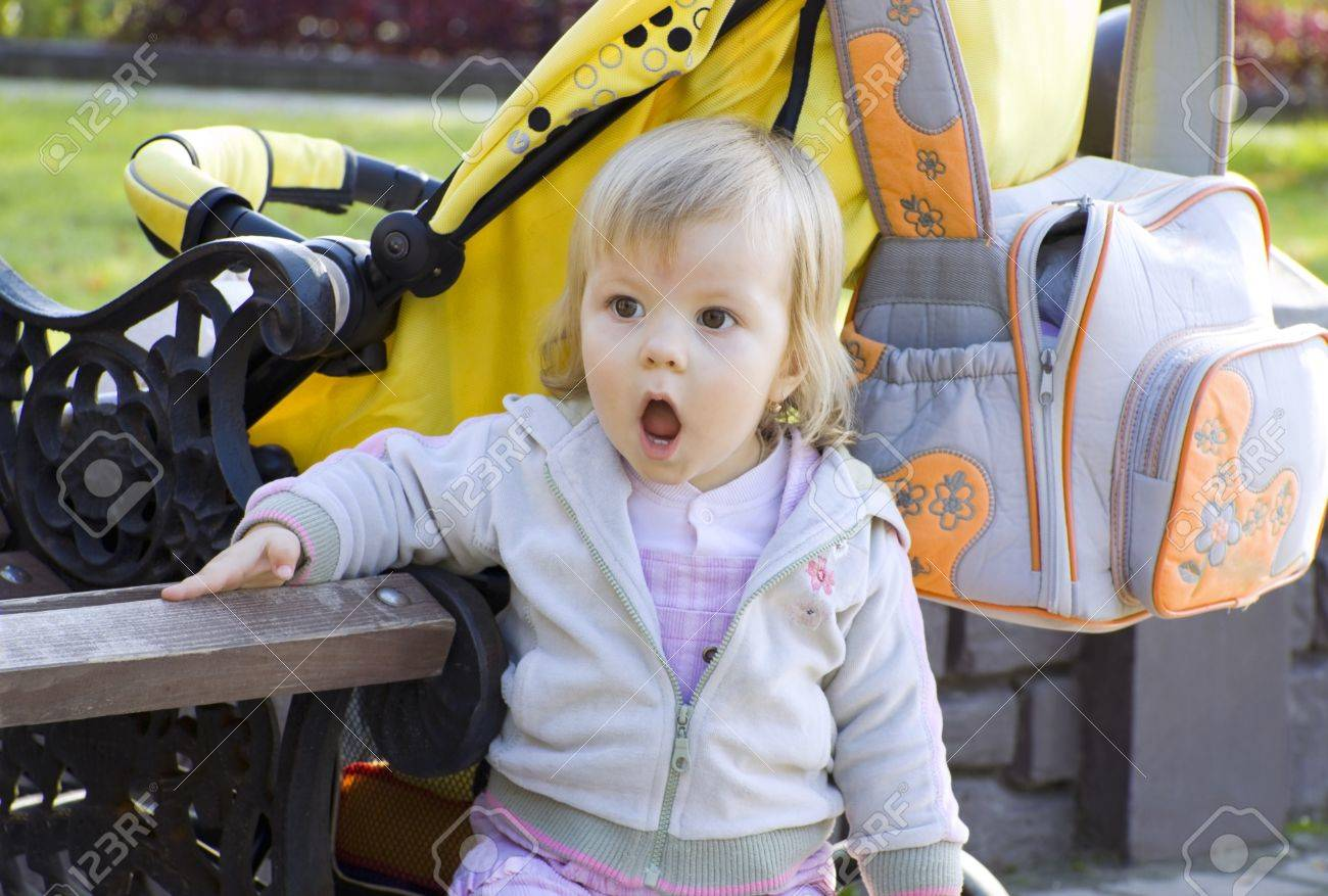 22c33bf828ba The child costs on open air with widely opened mouth and with astonishment looks  aside Stock