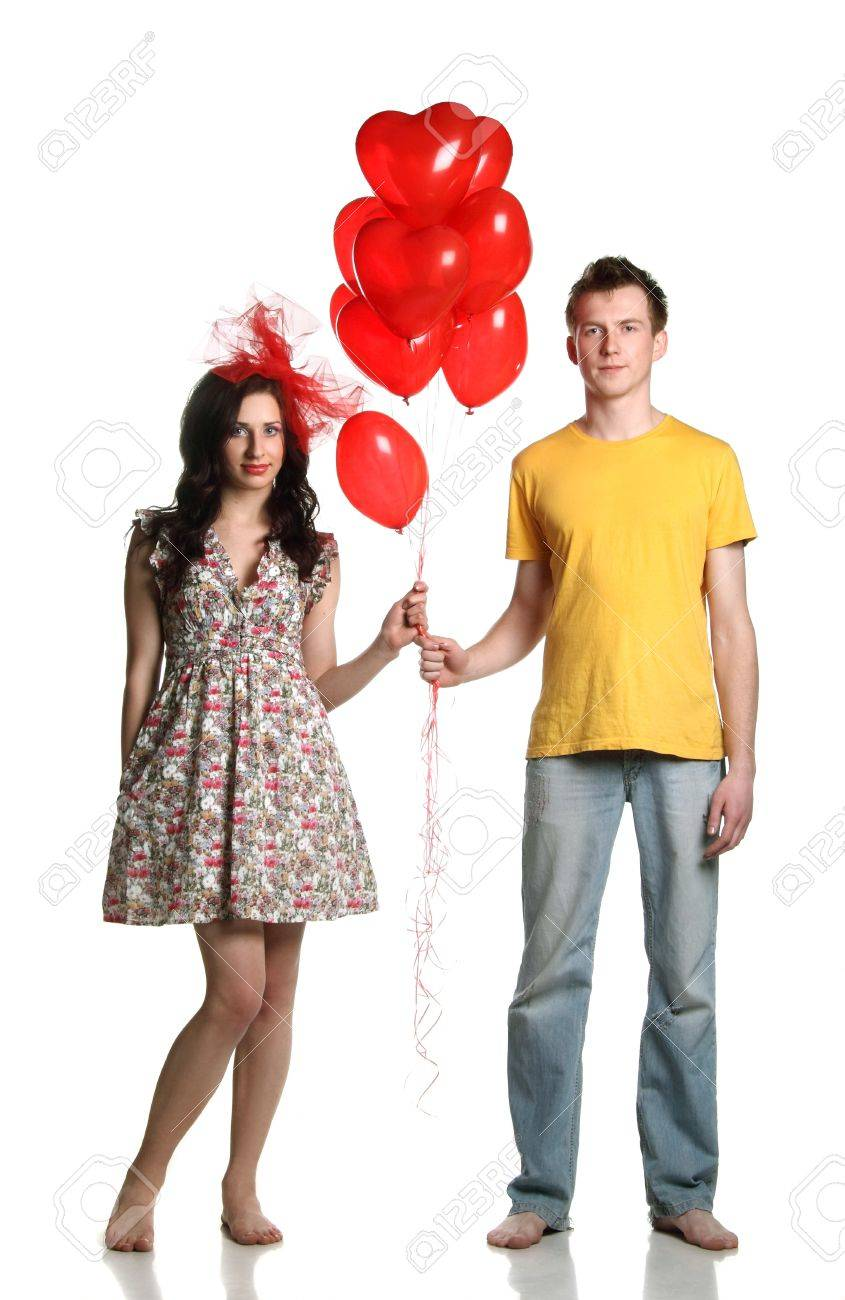 boy and girl with red balloons hearts Stock Photo - 13550466