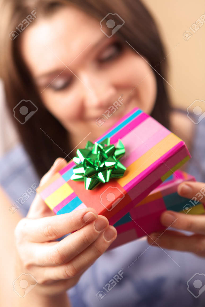 Beautiful young woman with gift box Stock Photo - 2346991