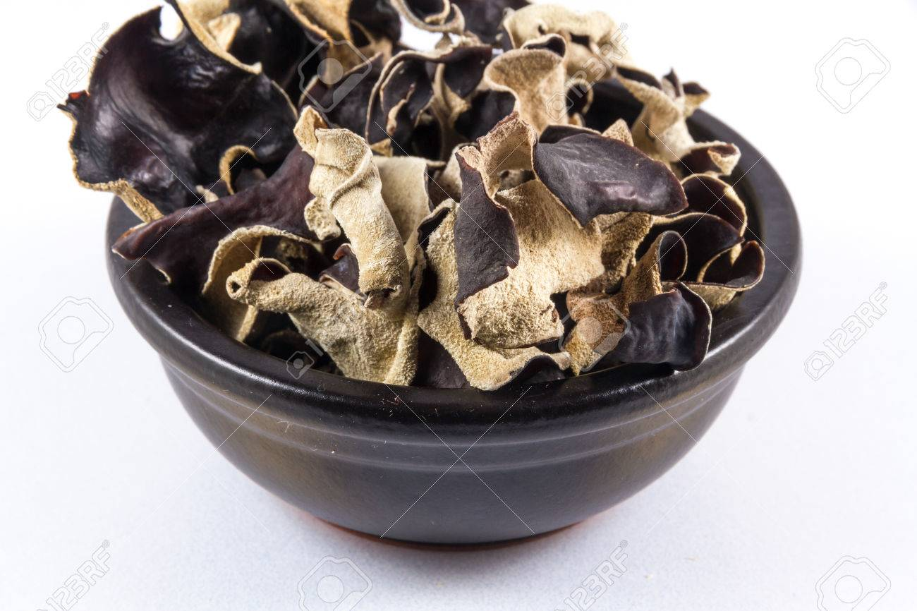 Black Ceramic Bowl With Dried Mushrooms Piled In, Auricularia ...