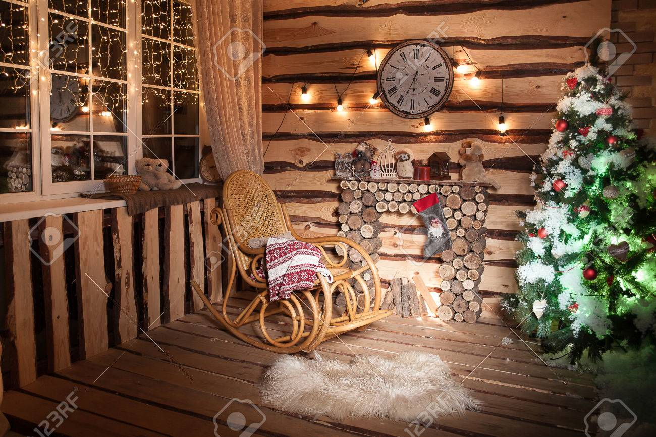 Stock Photo   Wooden Rome In Rustic House With Wooden Fireplace, Decorated  Christmas Tree And Rocking Chair