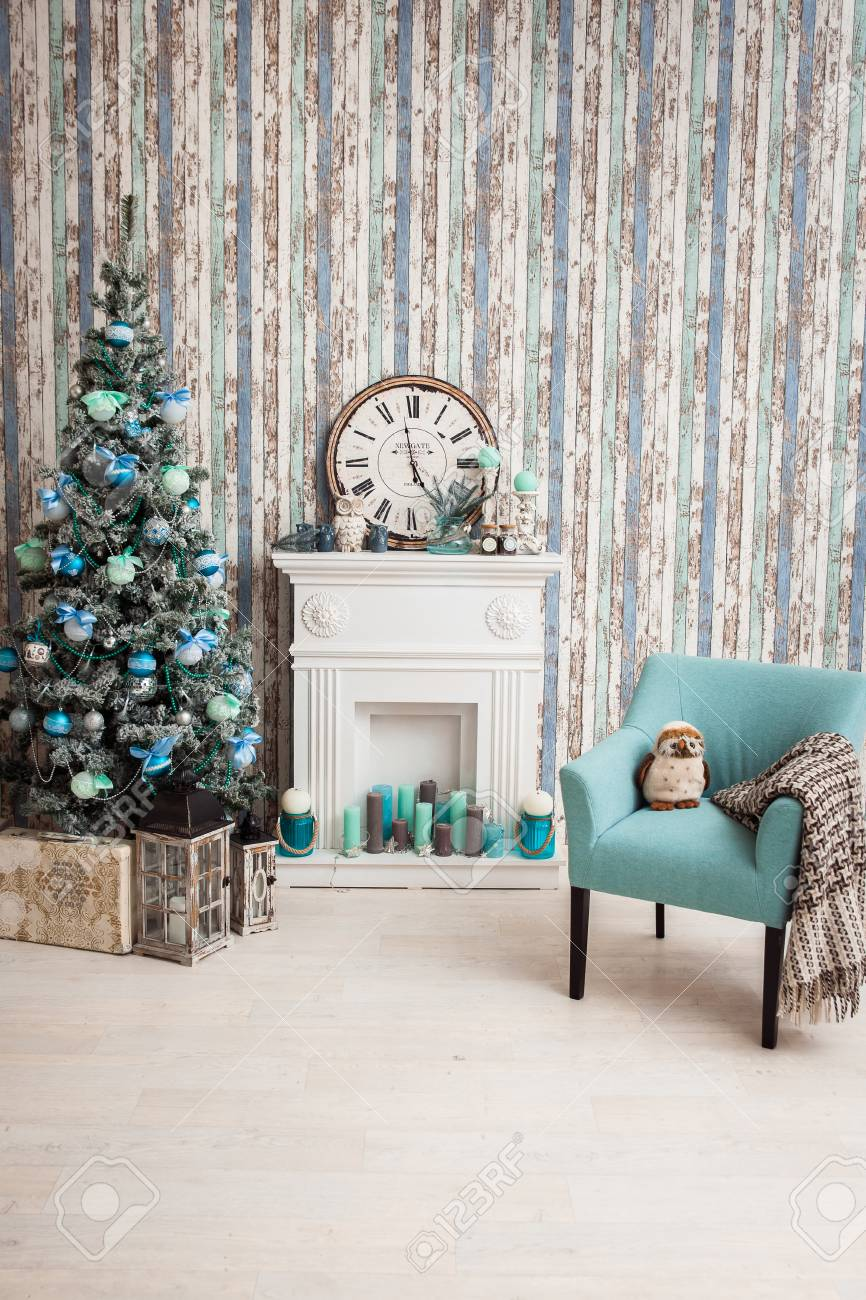 Christmas Tree In Living Room With Fireplace, Armchair And Wallpaper ...