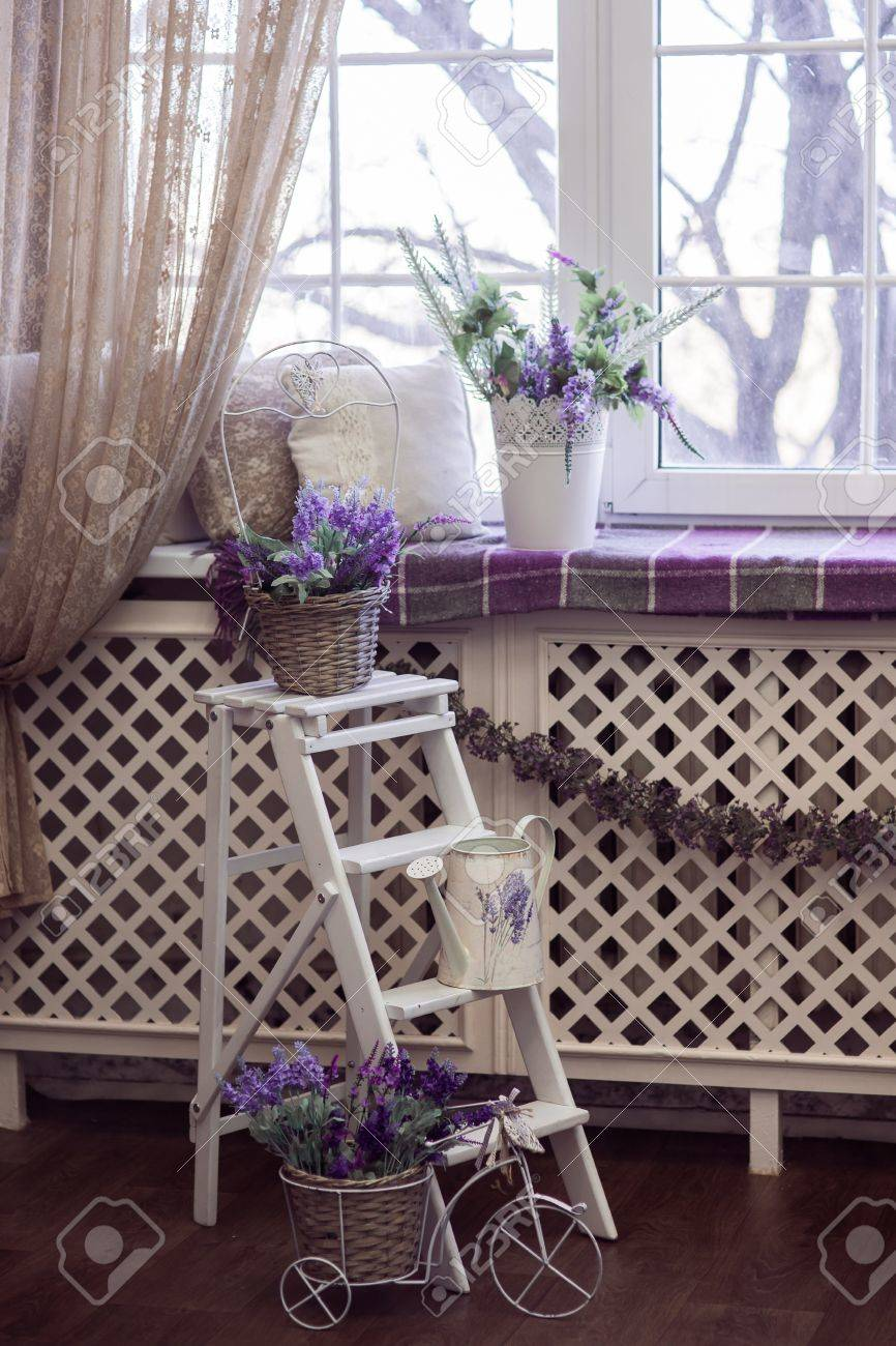 Lavender Flowers In White Pots, Wicker Baskets And Small Bicycle Stand On  The Stairs And