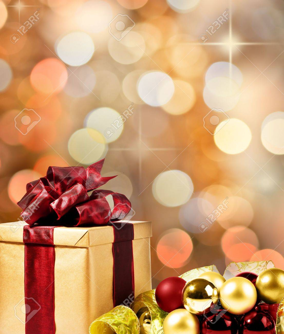 Christmas Present with decorative xmas bubbles and ribbon (gold, red and green) Stock Photo - 10418286