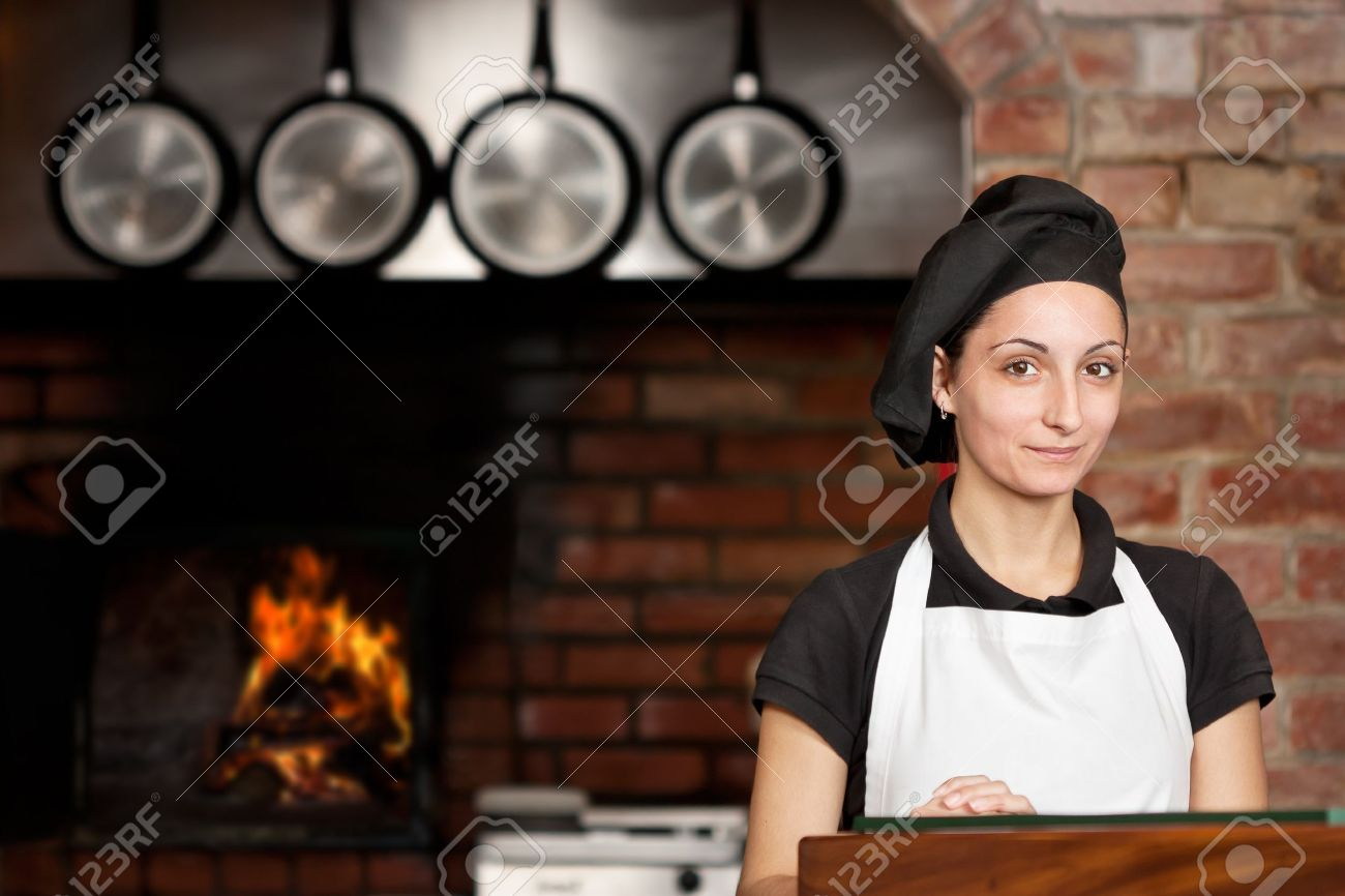 Woman Chef Is Standing At The Kitchen Entrance With The Wood ...