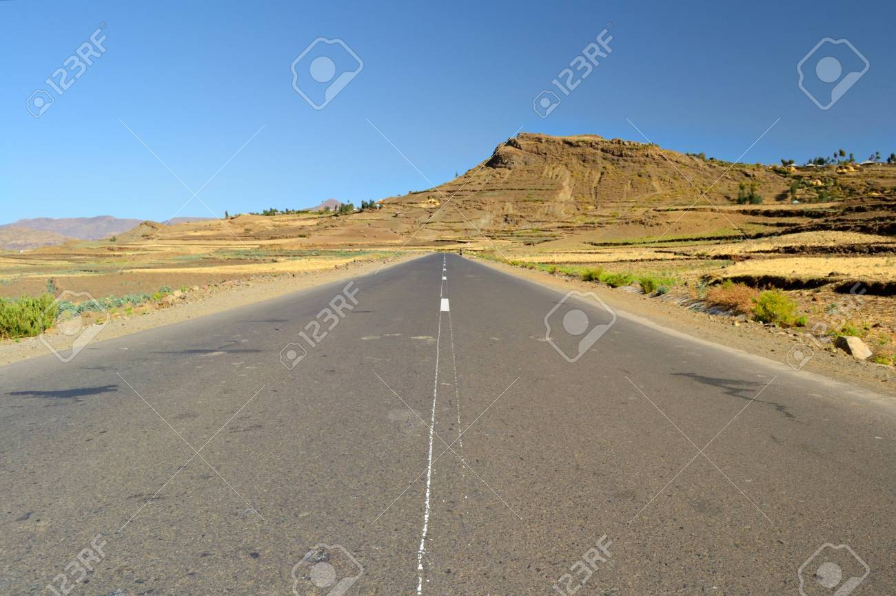 Straight ethiopian road, somewhere on the way to Lalibela among the teff fields of the central ethiopian plateau Stock Photo - 16206940