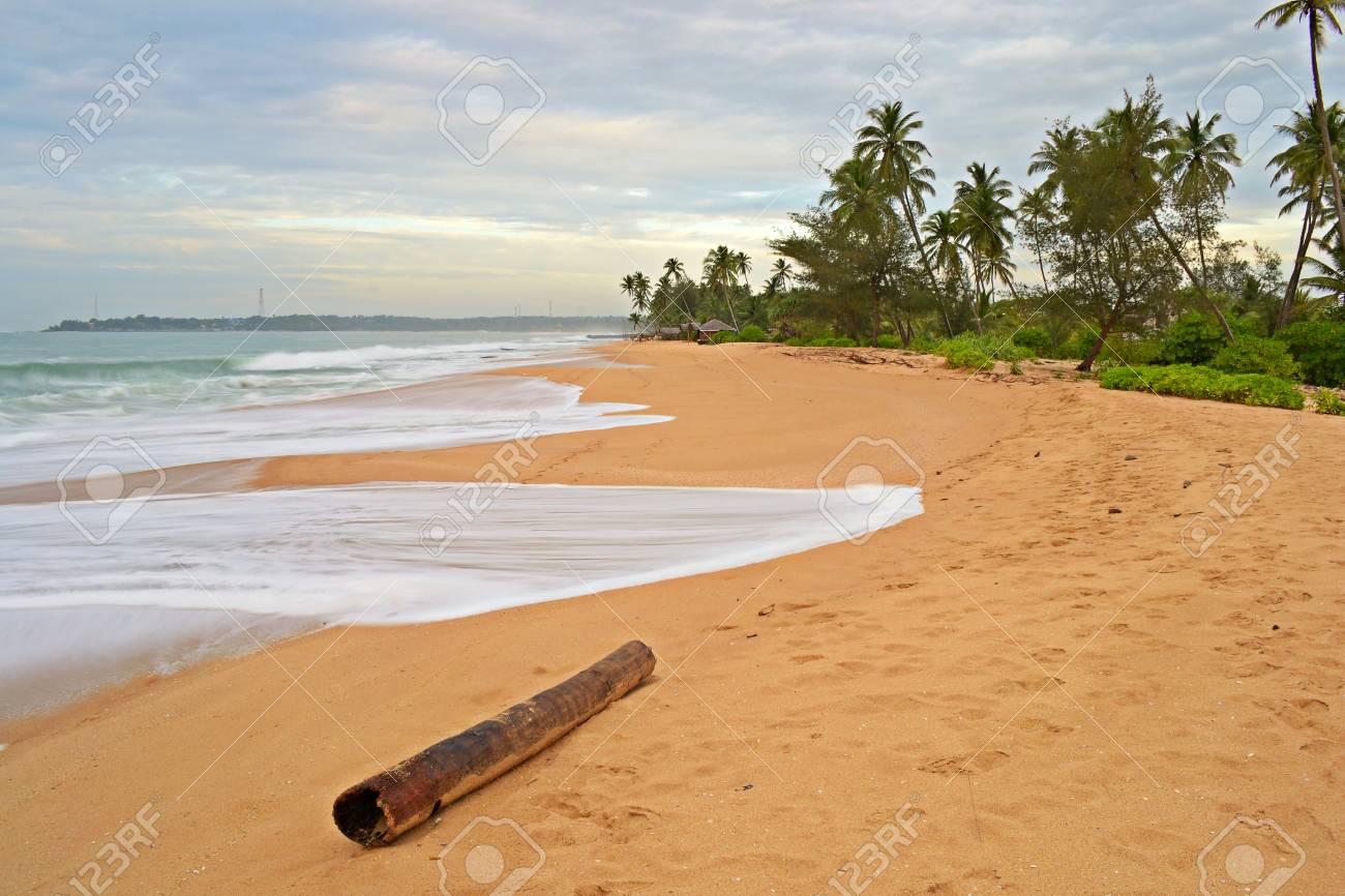 Blurred seascape, long exposure taken on tropical beach during monsoon time at dusk, Tangalla, Sri Lanka Stock Photo - 17424231