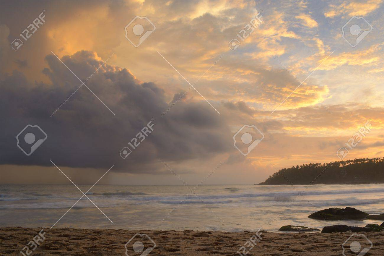 Like an atomic explosion, clouds gathering at the horizon at dusk taken by a double exposure shot from the tropical beach of Mirissa, Sri Lanka, during monsoon time Stock Photo - 17610320