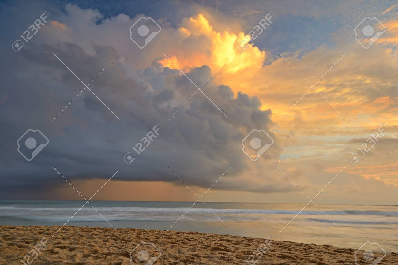 Like an atomic explosion, clouds gathering at the horizon at dusk taken by a double exposure shot from the tropical beach of Mirissa, Sri Lanka, during monsoon time Stock Photo - 17610331