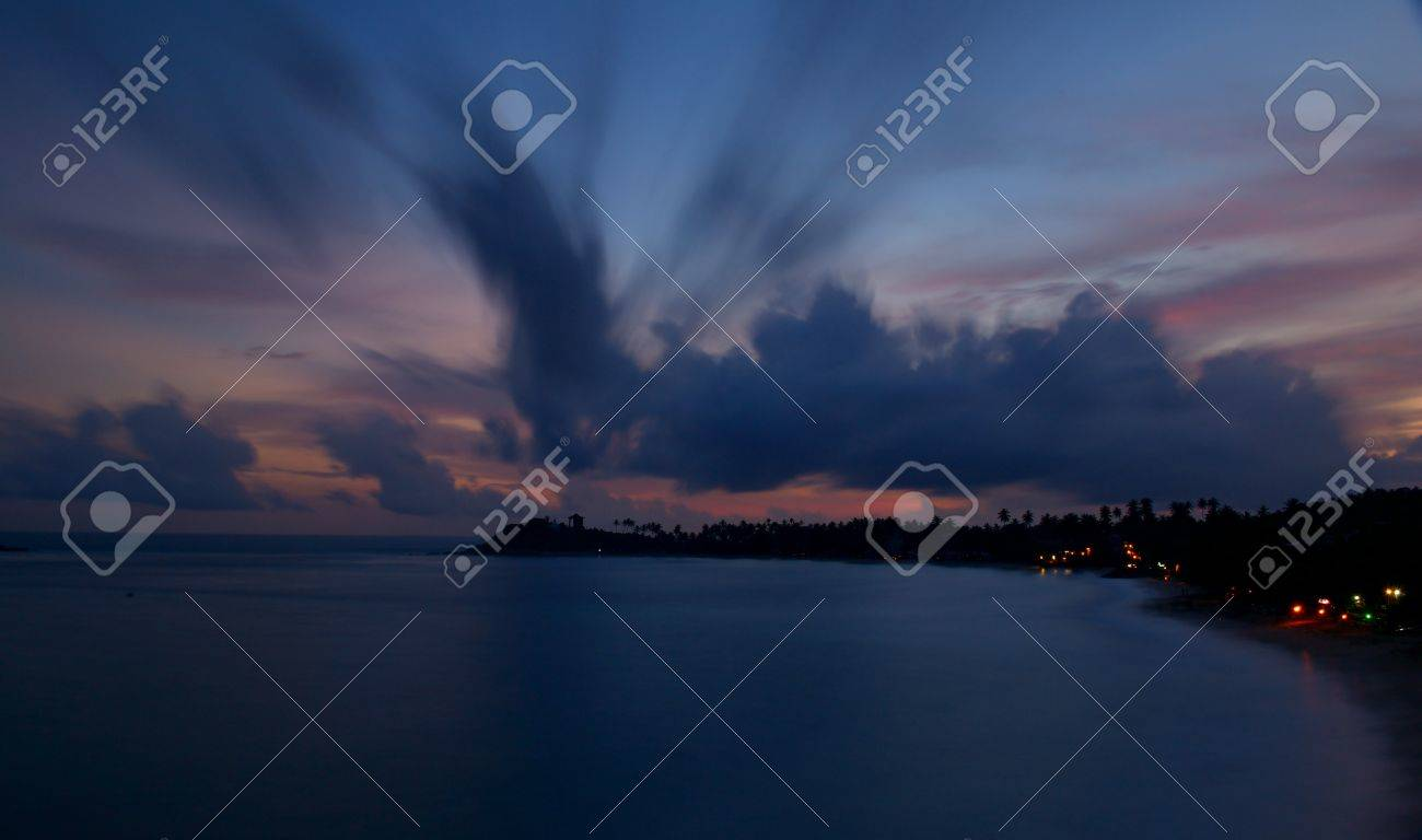 Blurred motion shot taken with very long exposure on tropical beach during monsoon time at dusk, Unawatuna, Sri Lanka Stock Photo - 17723272
