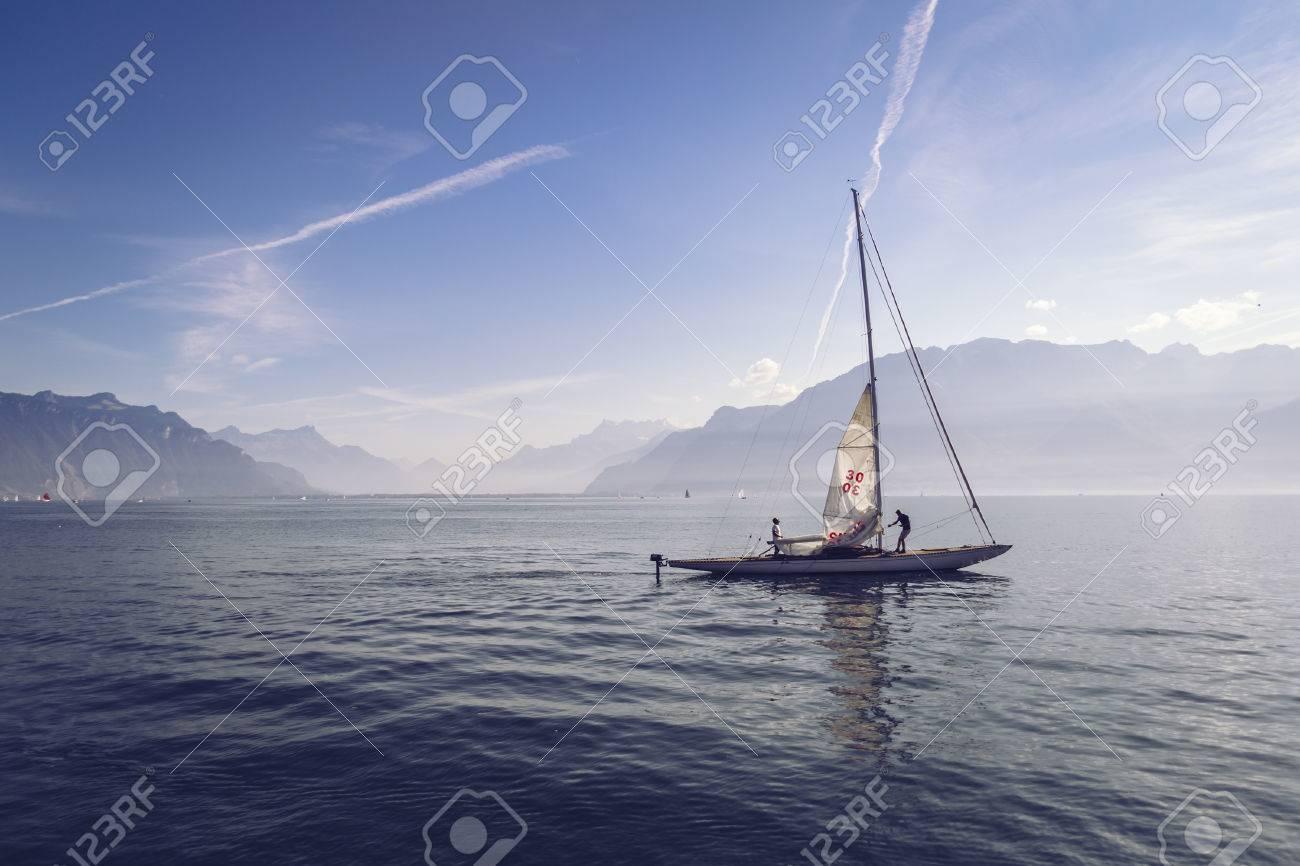 Vevey, Switzerland - September 8, 2014: Sailboat on Lake Geneva near the city of Vevey. Stock Photo - 81025402