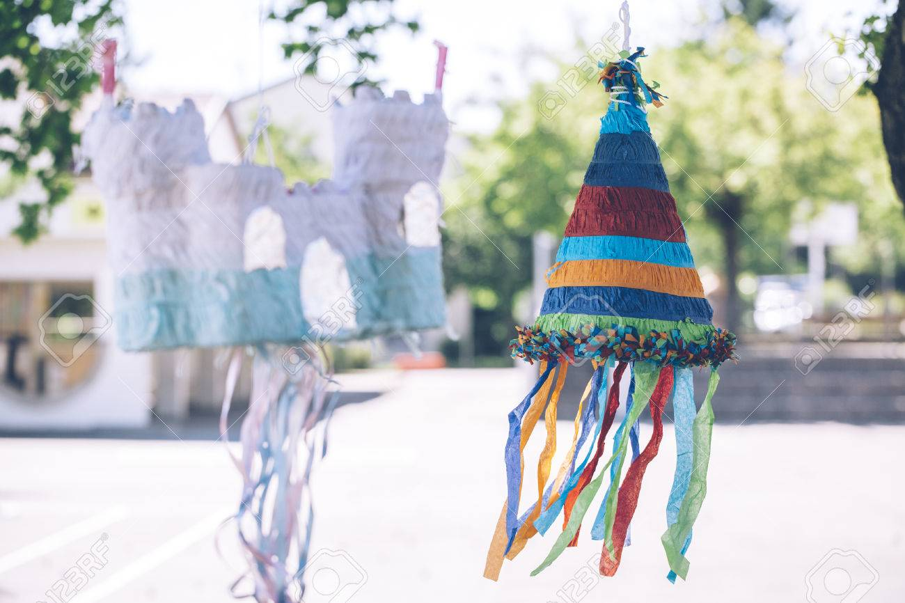 colorful castle and cone shaped pinatas Stock Photo - 80937631