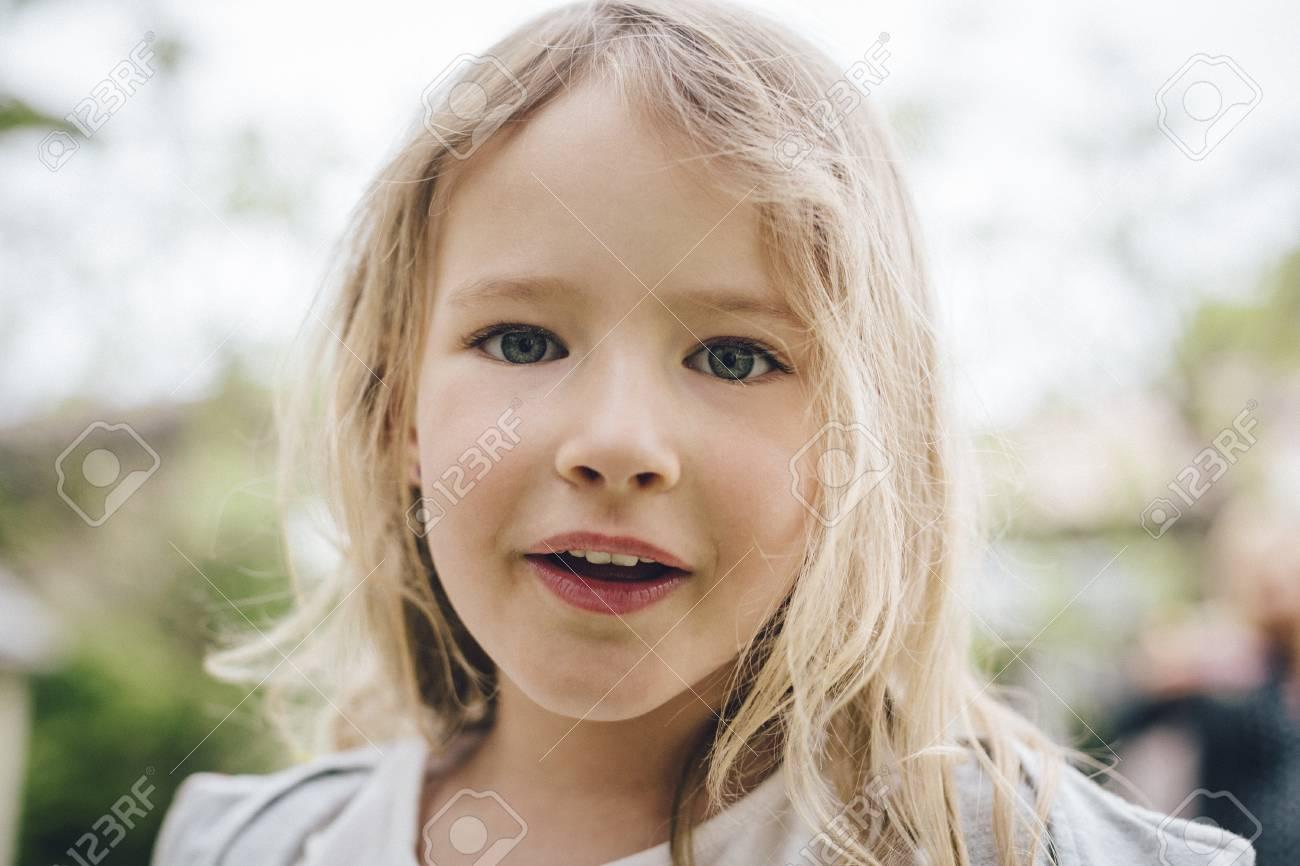 Portrait of a blond little girl Stock Photo - 84647059