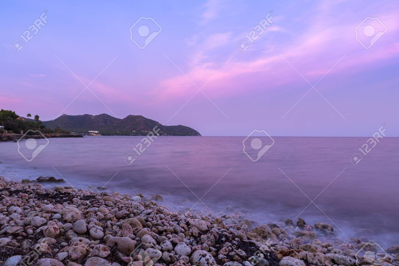 The mediterranean sea on the Spanish island of Mallorca at dusk. Stock Photo - 85255949