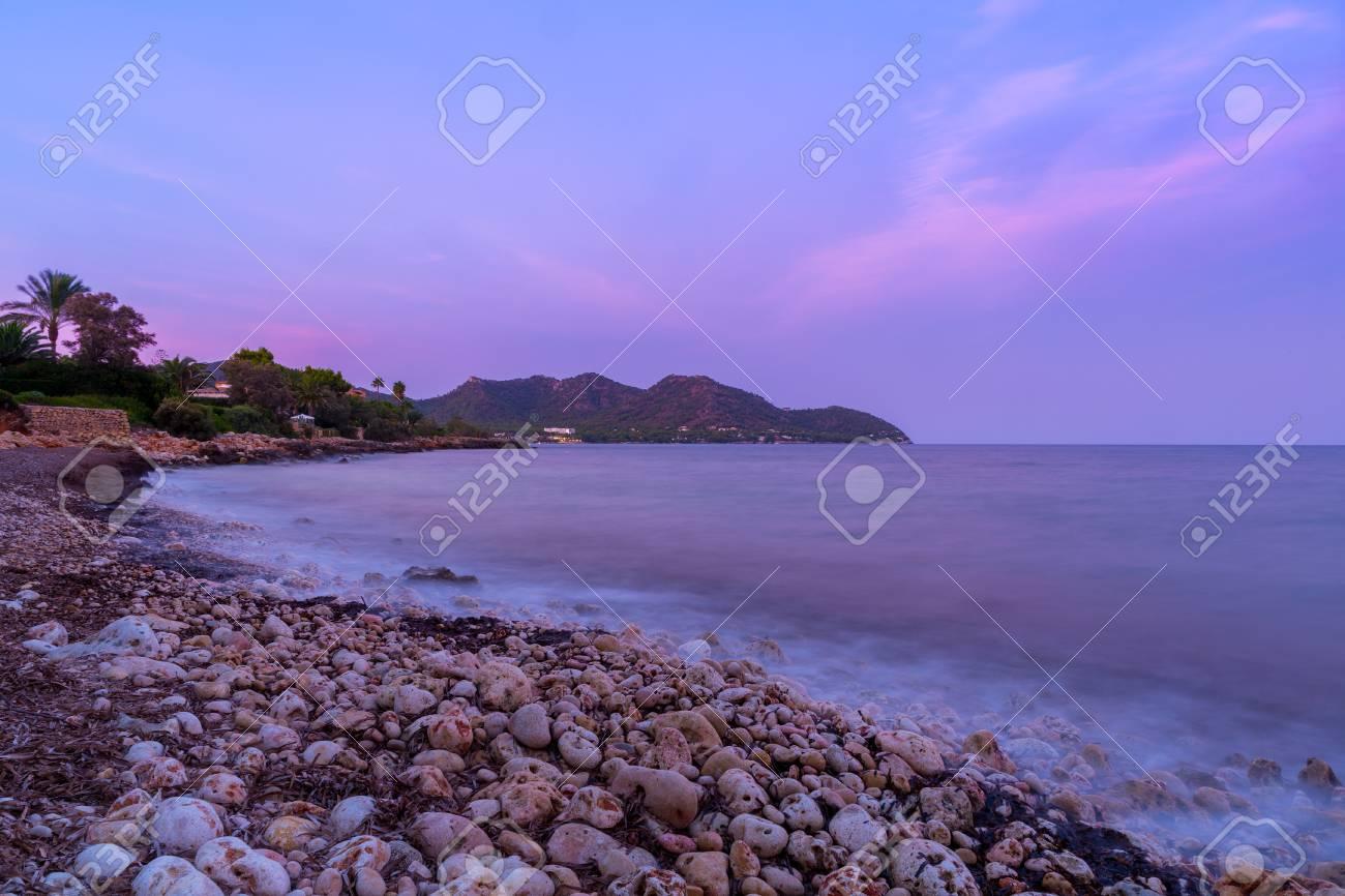The mediterranean sea on the Spanish island of Mallorca at dusk. Stock Photo - 85255947