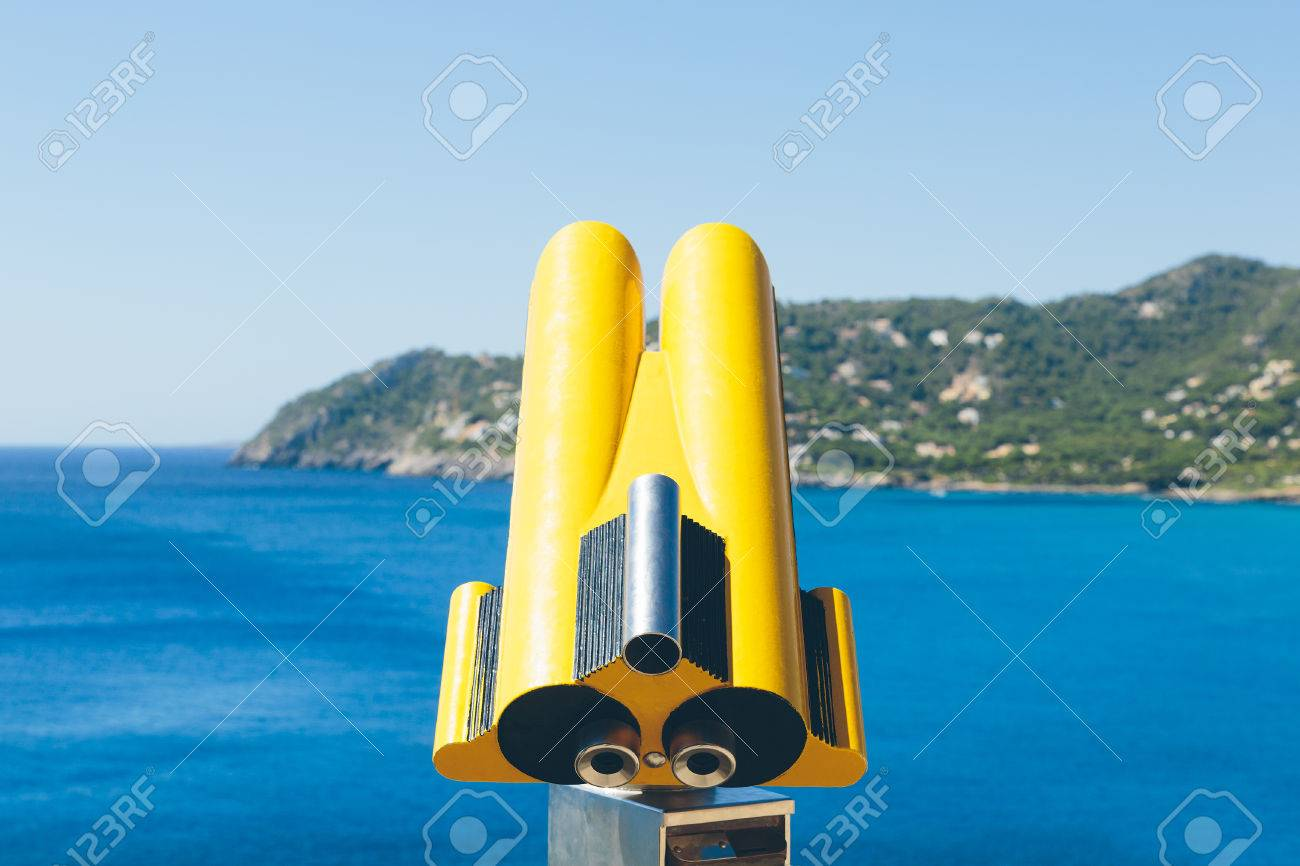 Coin operated binoculars overlooking the mediterranean sea on the island of Mallorca, spain. Stock Photo - 85255952