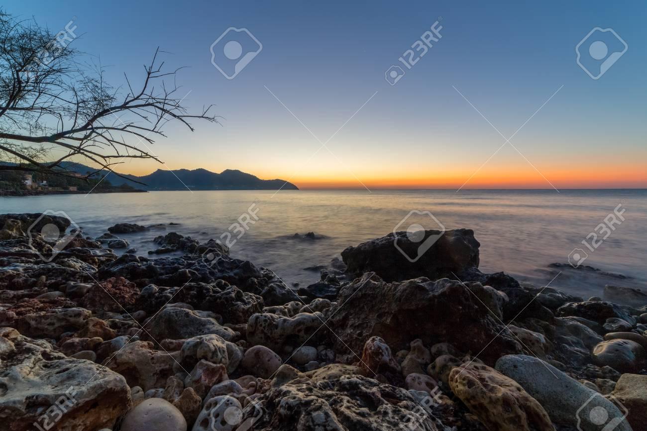 The mediterranean sea on the Spanish island of Mallorca at dawn. Stock Photo - 85161789