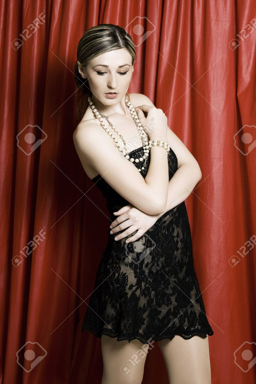 A beautiful brunette woman in front of a red curtain Stock Photo - 4854207