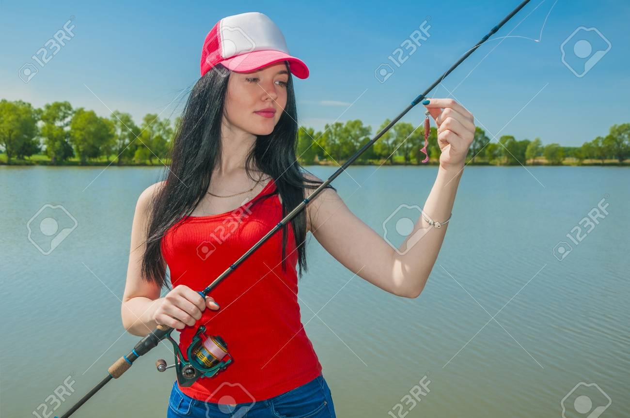 Young Fisherwoman Preparing For Fishing. Girl With Fishing Rod ...