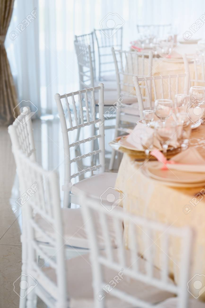 White Decorative Chairs In The Wedding Restaurant Stock Photo