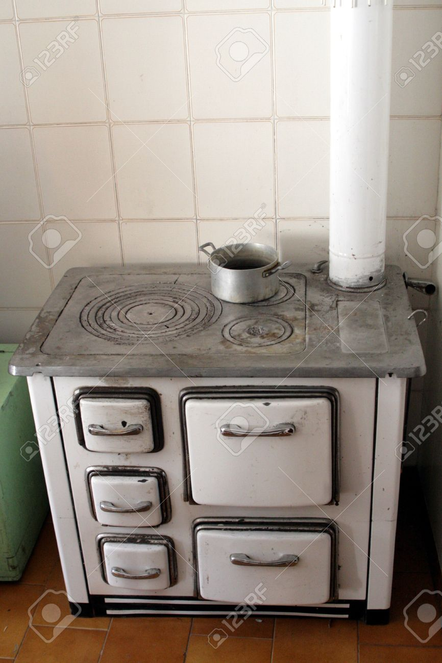 Old Wood Stove In An Old Kitchen Of A House In The Mountains Stock Photo