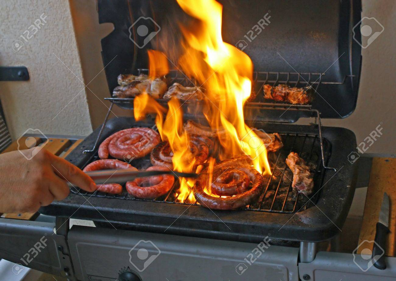 Mixed Grill Of Meat In The Outdoor Garden In Gas Fireplace Stock ...