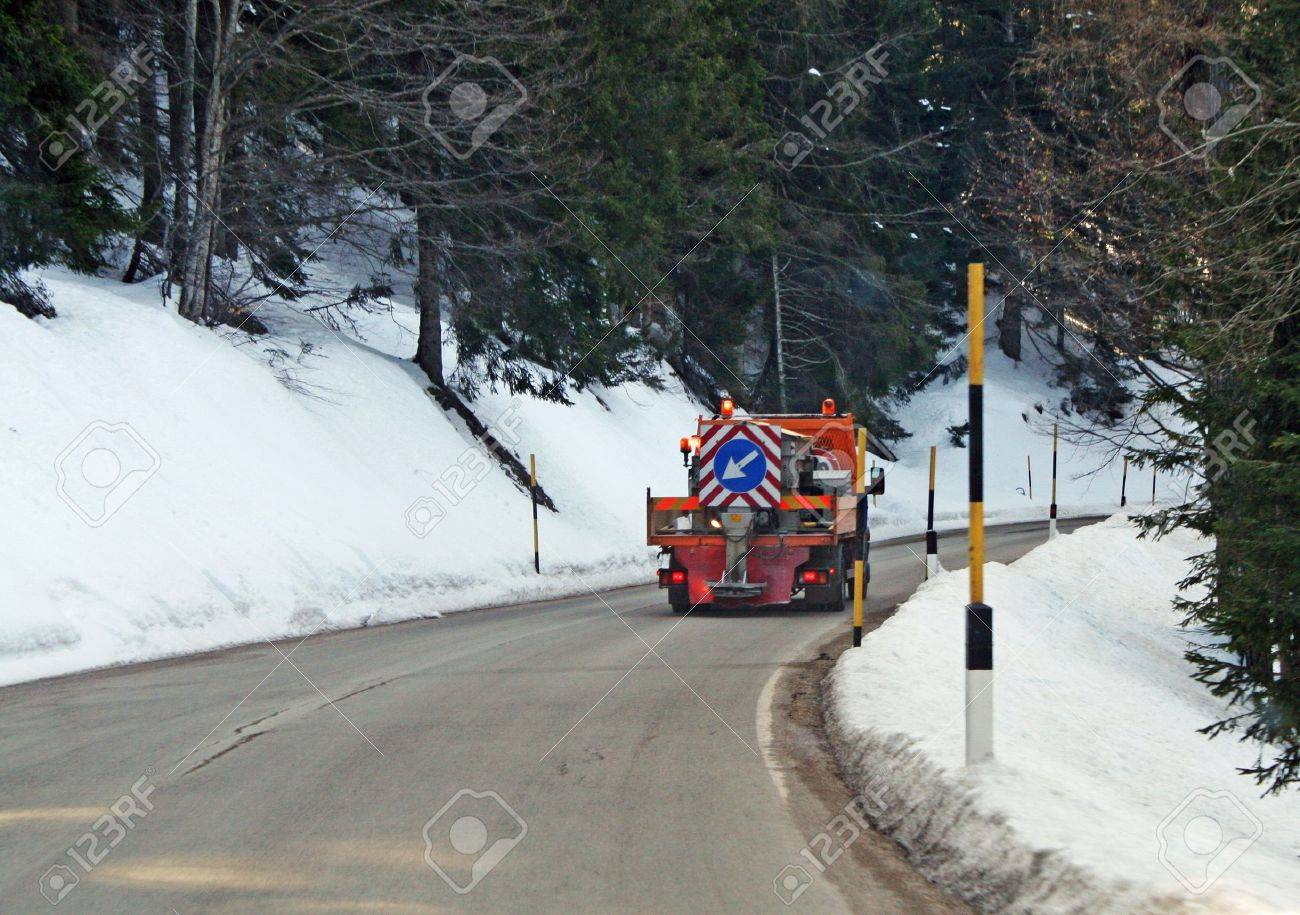 municipal truck with salt spreader system to prevent formation of ice on mountain roads Stock Photo - 12365745