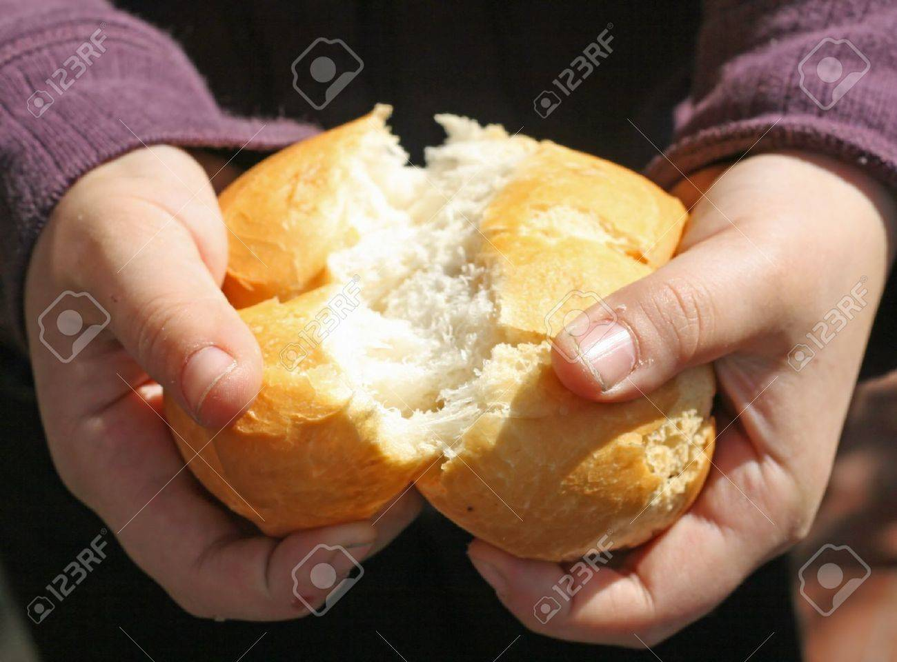 child who breaks a piece of bread with your hands Stock Photo - 12647523