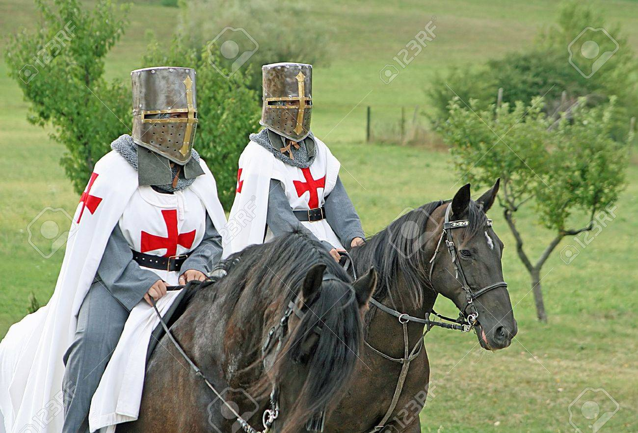 two medieval crusaders shall strutting with their horses blacks Stock Photo - 13612128