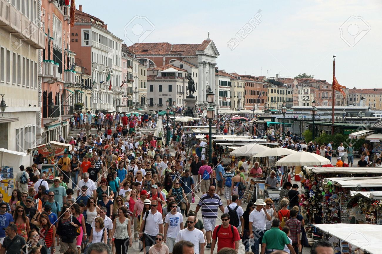 lots of people and tourists around Venice in Italy Stock Photo - 14762647