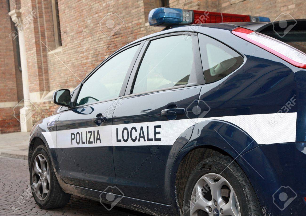 blue municipal police car patrol in a town in Italy Stock Photo - 17590117