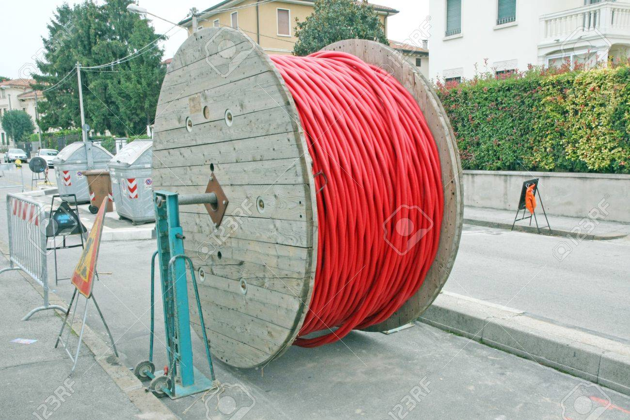 huge coils of red high-voltage power cable in the middle of the road Stock Photo - 17661282