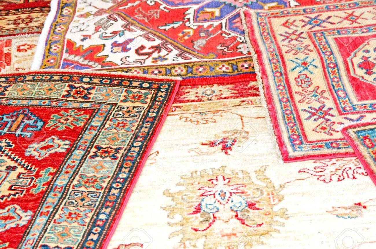 collection of antique oriental carpets expensive on display in the antiques boutique Stock Photo - 17799526