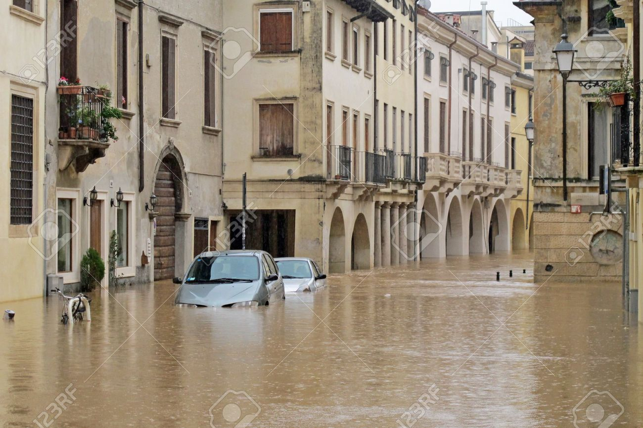 cars in the streets and roads submerged by the mud of the flood after the flooding of the River Stock Photo - 18119182
