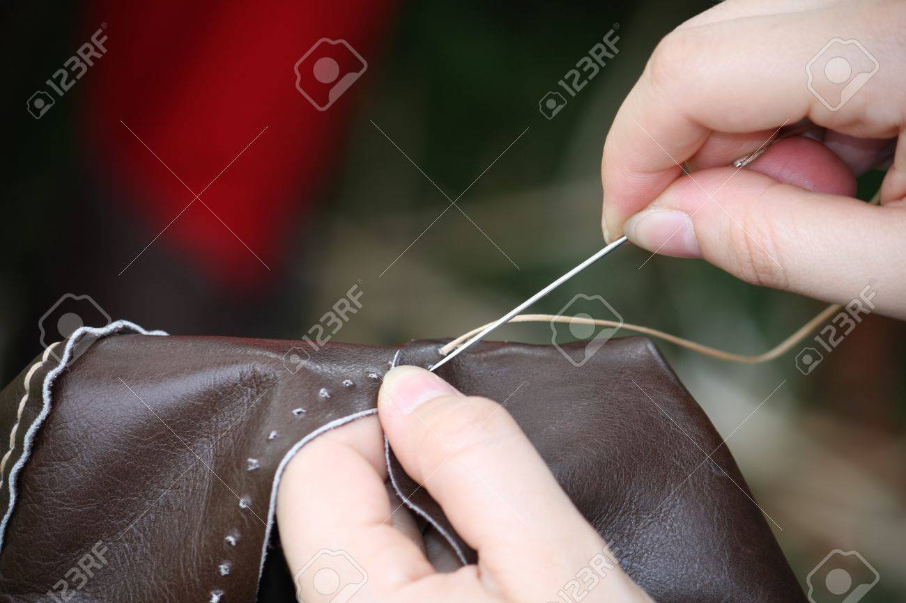 woman while sewing a dress in leather with needle and thread Stock Photo - 19471105