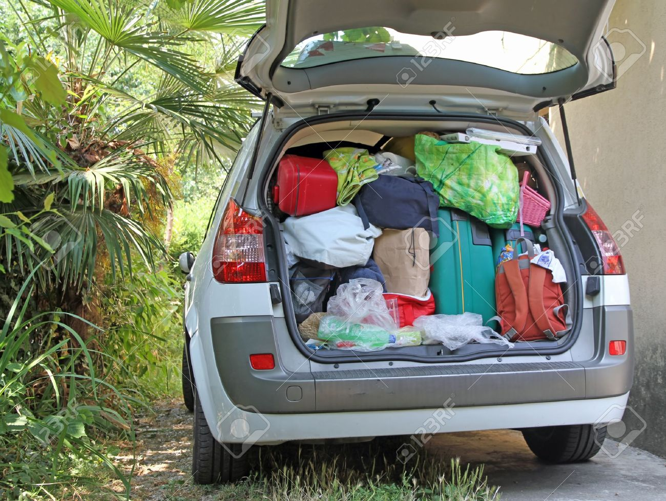 Car Very Full Of Suitcases And Bags Before Leaving For Summer Vacation Stock Photo