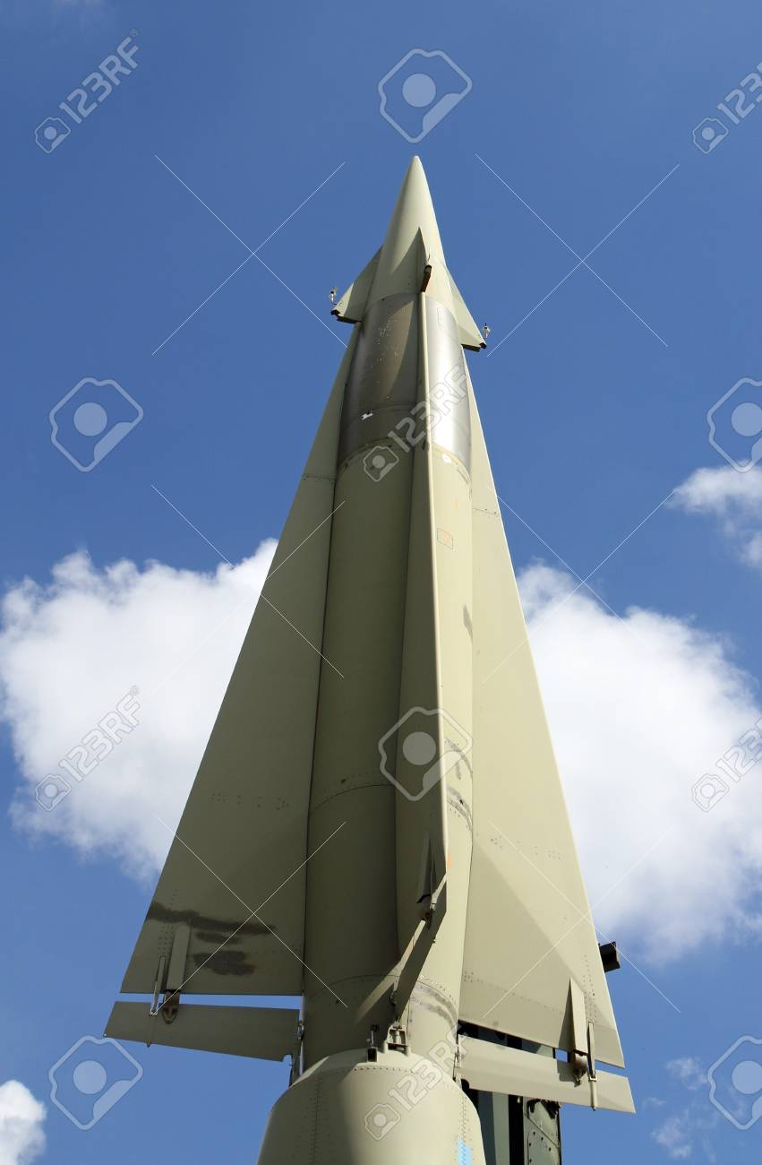 rocket with military explosive warhead for the war and blue sky and white clouds Stock Photo - 22051888
