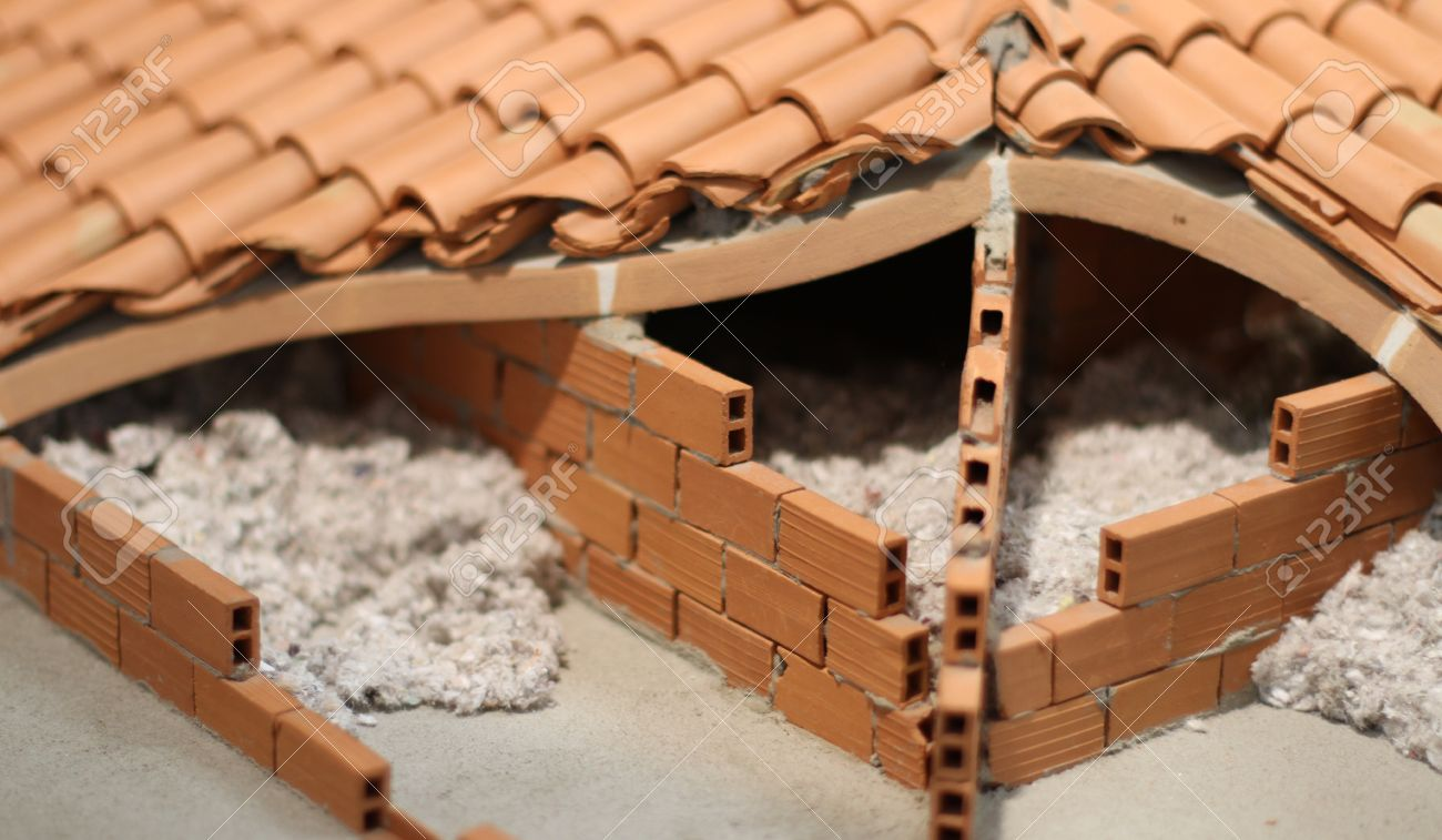 Attic Insulation With The Insulating Material Of The House Made Of  Terracotta Brick Red Stock Photo