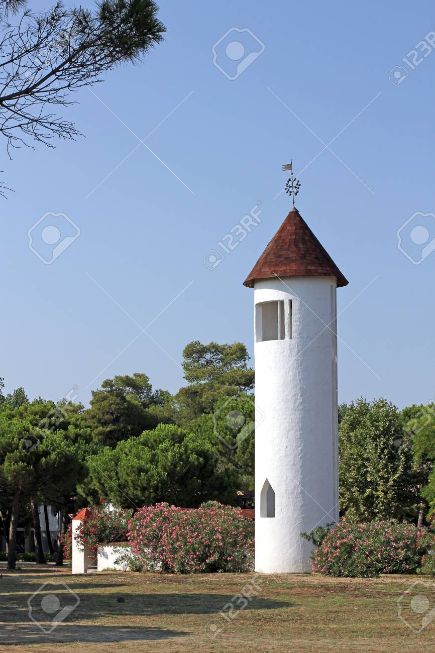 little White Bell Tower of a church in southern Italy Stock Photo - 22542312