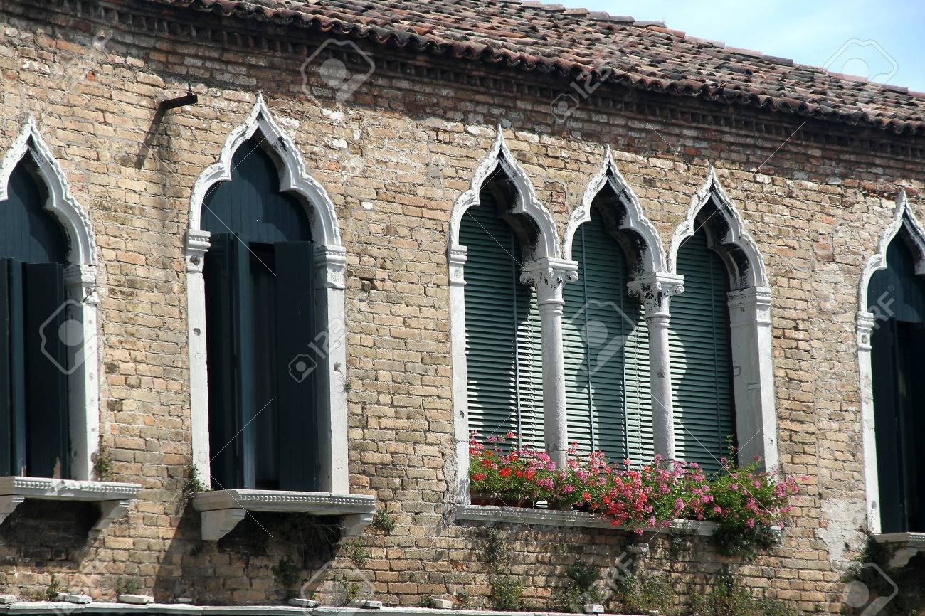 Venetian Style ancient flowery balcony in venetian style with arched windows