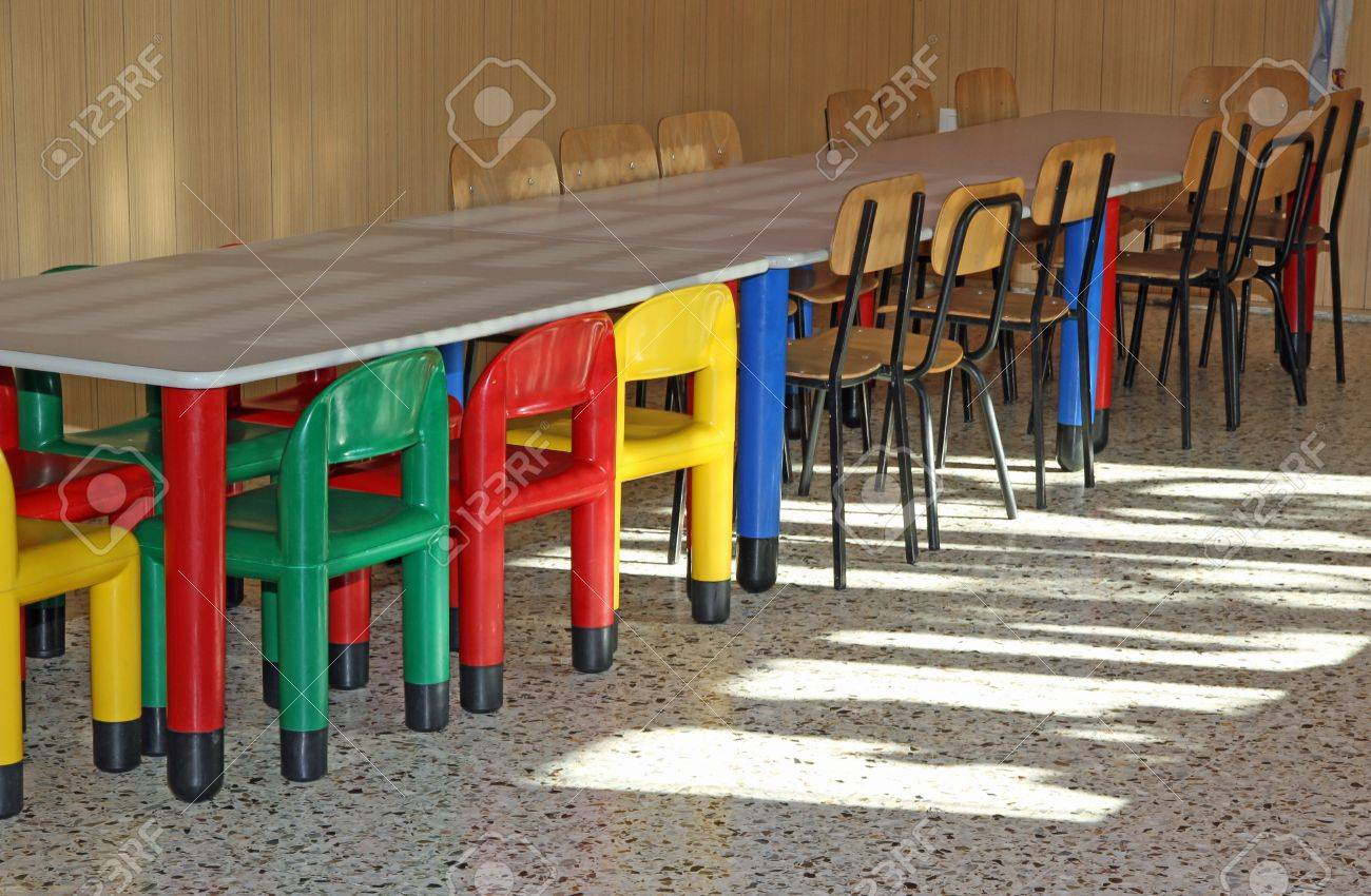 colored plastic little chairs in the nursery canteen for young