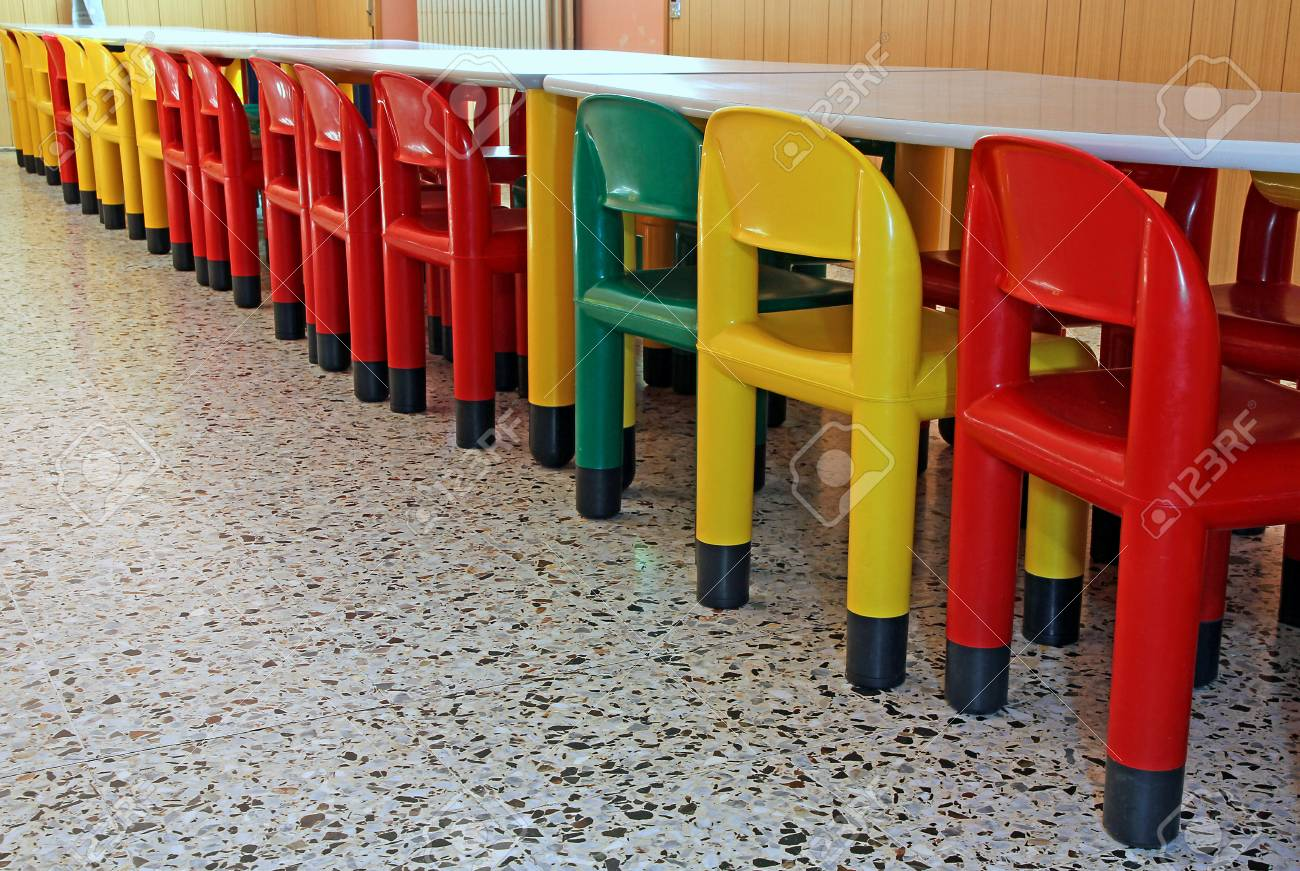 long line of colored plastic chairs in the refectory of the nursery