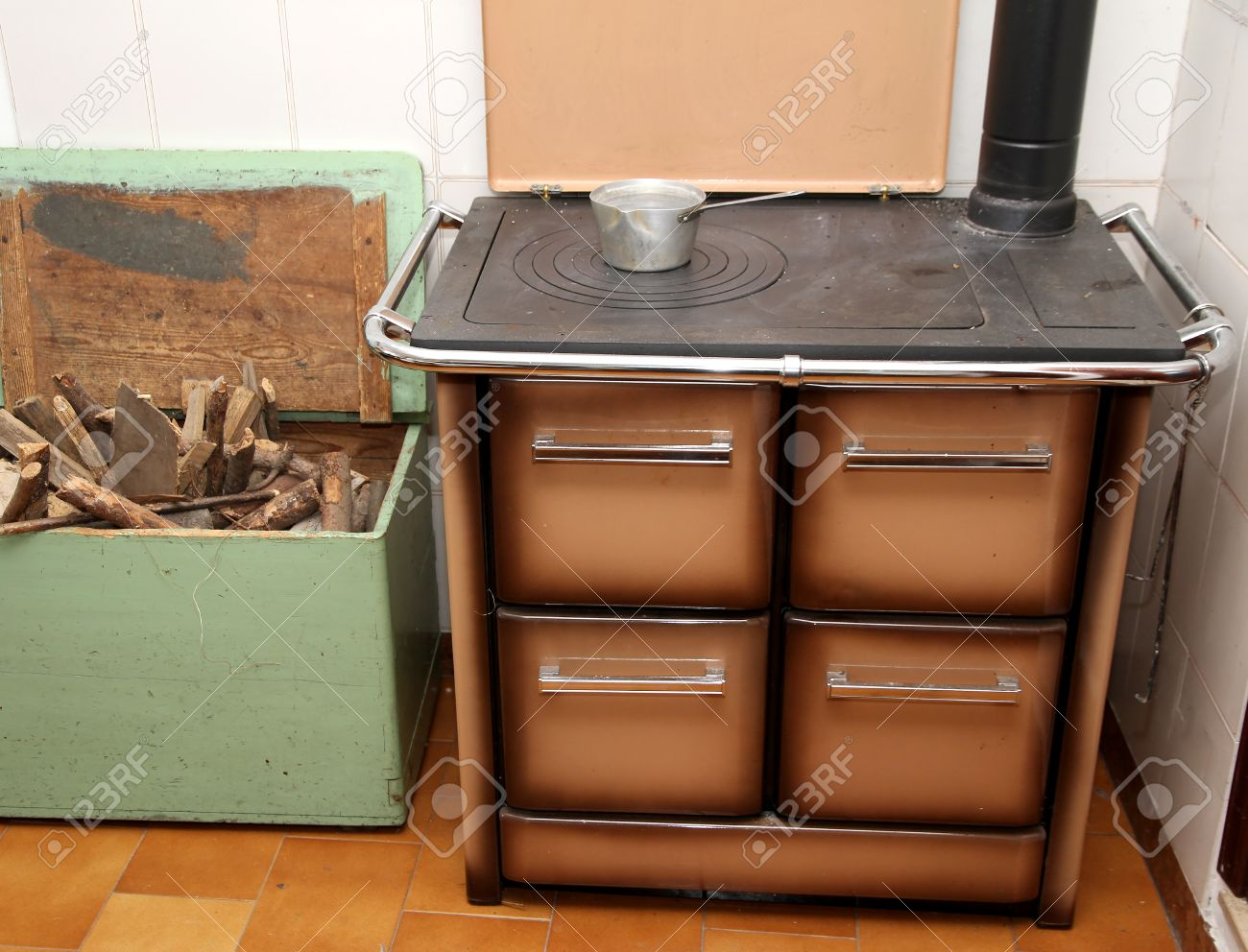 antique wood burning stove in a kitchen of a lovely mountain