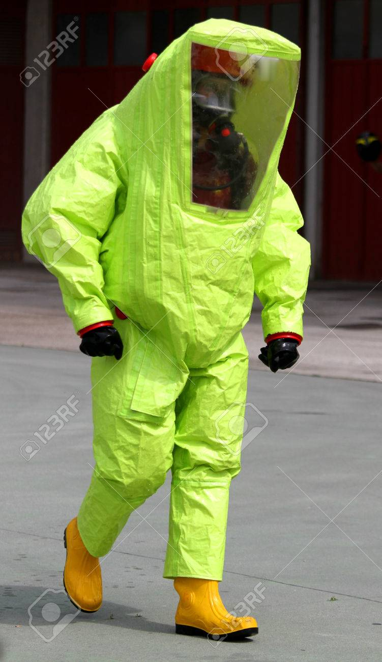 person with anti radiation suit yellow and yellow rubber boots to guard against the risk of bacteriological and chemical biological attack Stock Photo - 28758817