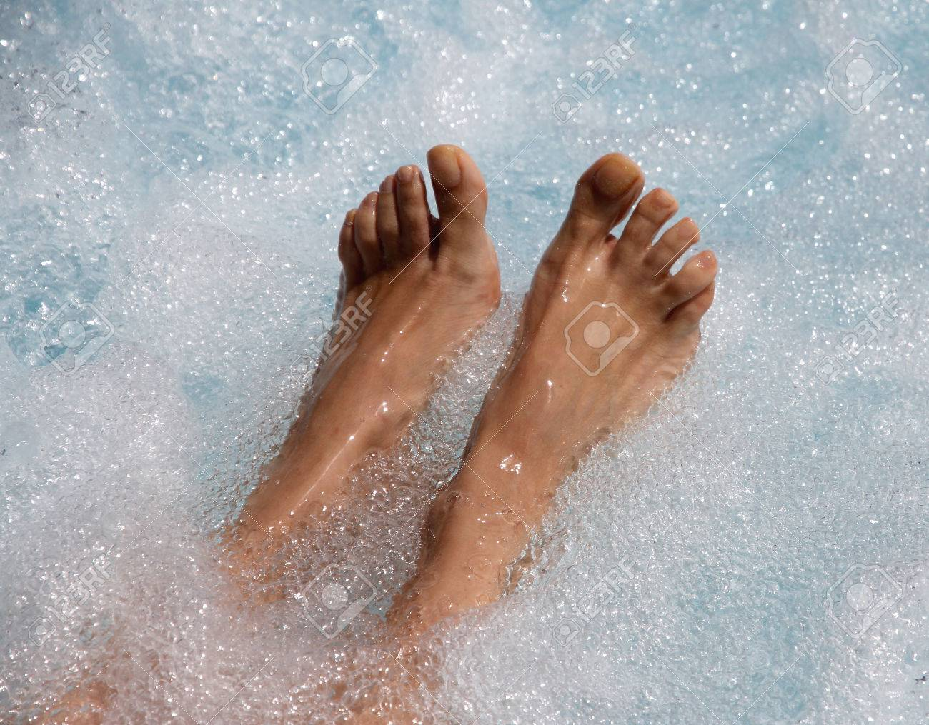 Two Beautiful Women\'s Feet In The Jacuzzi To Facilitate Venous ...