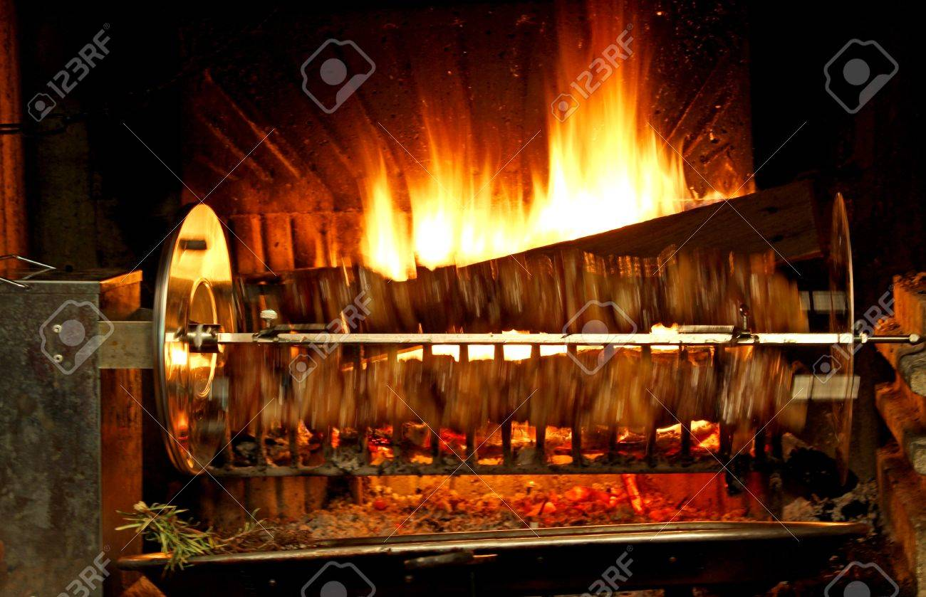 Fire Lit In The Fireplace And The Spit Which Runs Very Fast With ...