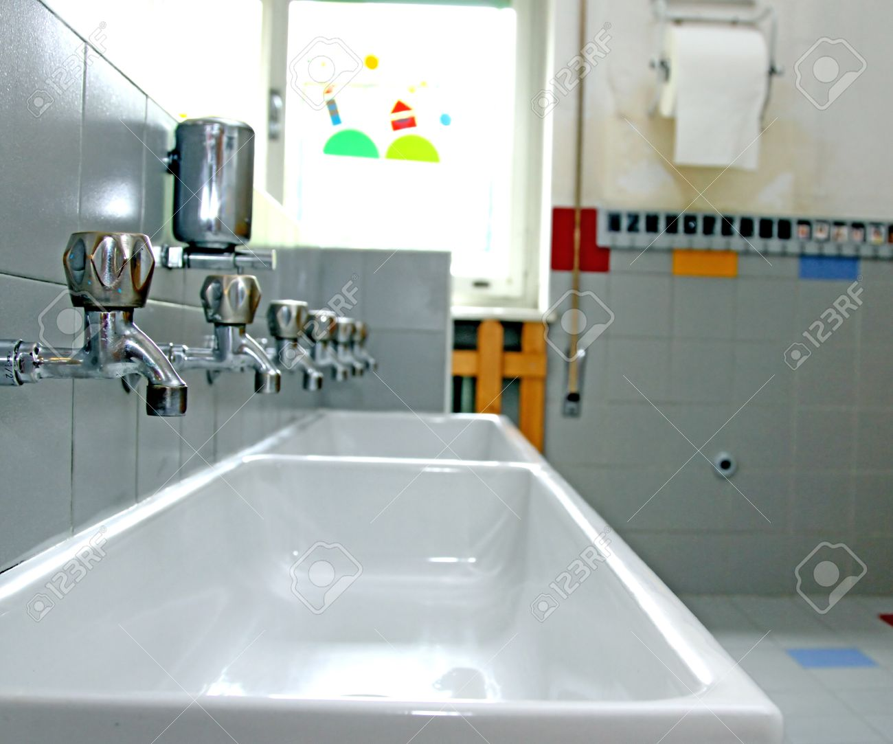 Sinks And Washbasins With Very Low Taps In The Toilets Of A Nursery ...