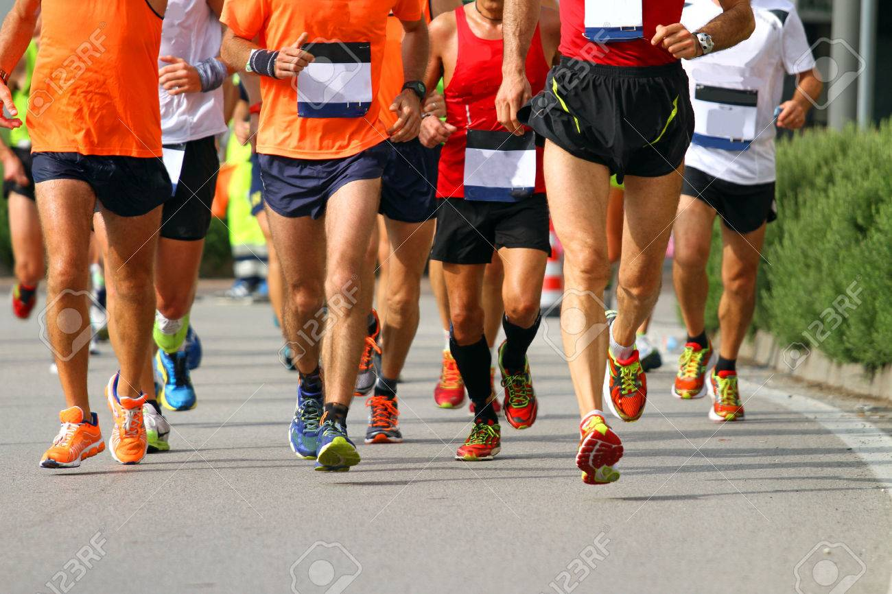 muscular legs of athletes engaged in long international marathon Stock Photo - 32247994
