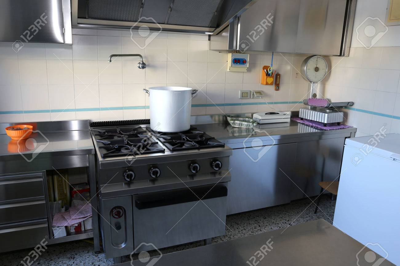 Large Industrial Kitchen With Big Gas Stove And The Giant Aluminum Pot On Fire Stock