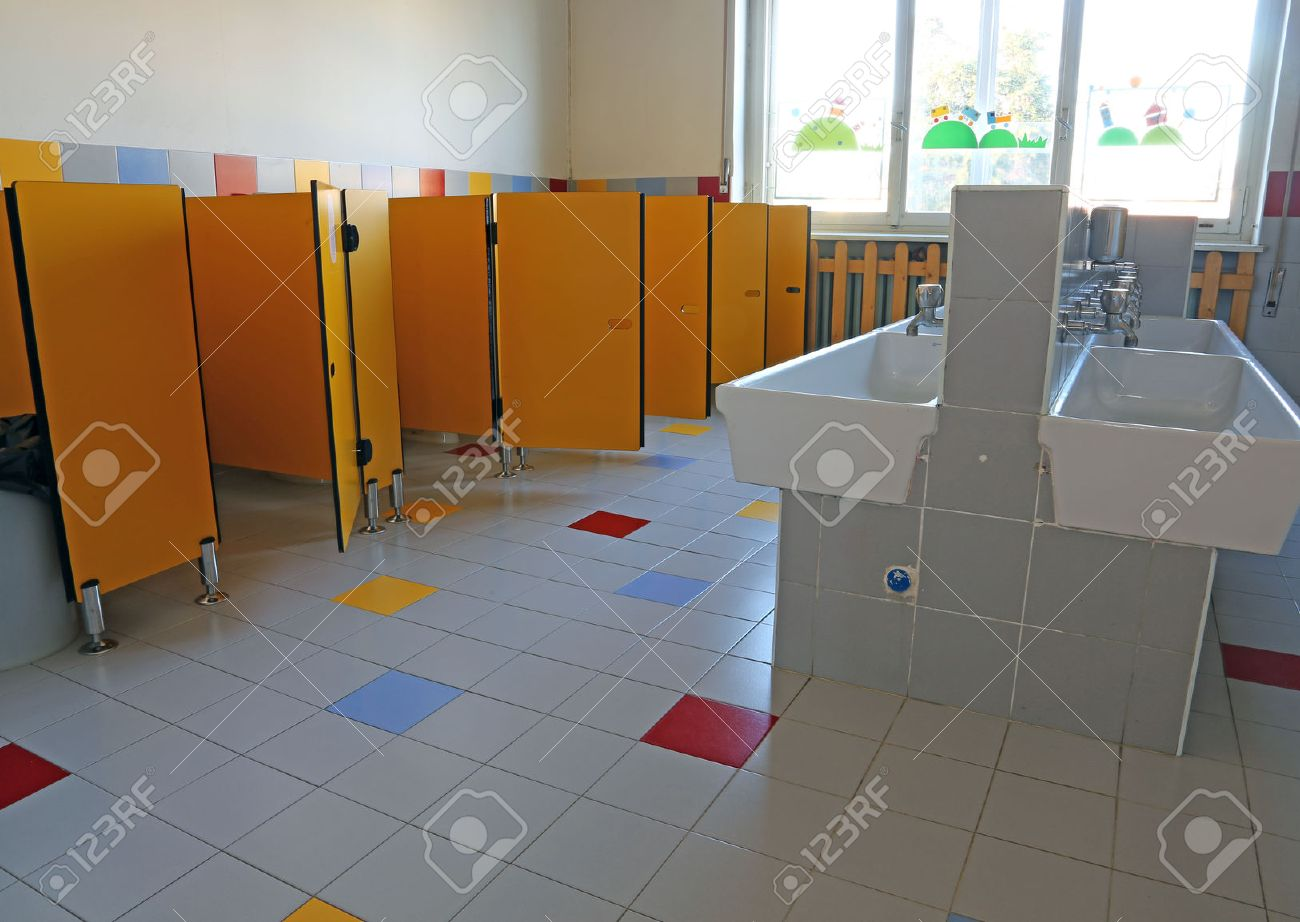 inside the bathroom of the nursery school with white ceramic sinks and doors yellow Stock Photo & Inside The Bathroom Of The Nursery School With White Ceramic.. Stock ...